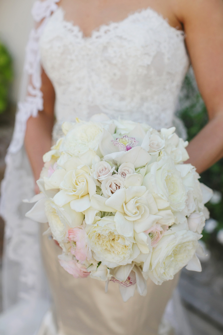 White and light pink floral bouquet with a few orchids