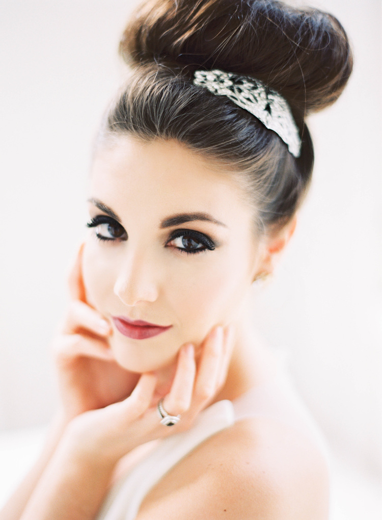 Beautiful bride with her hair in a bun and a silver barrette  in her hair