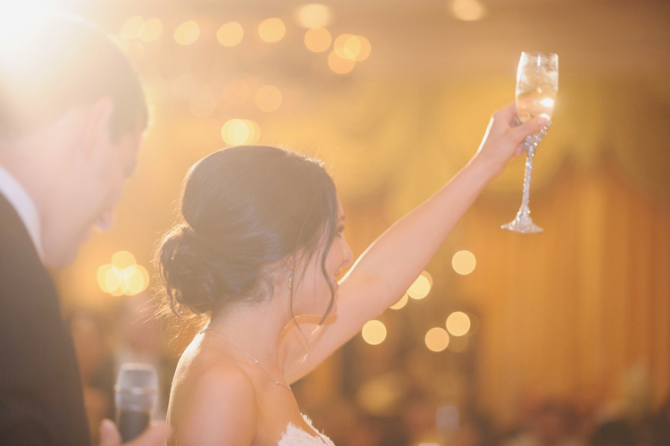 Couple giving a toast and holding up their champagne glasses