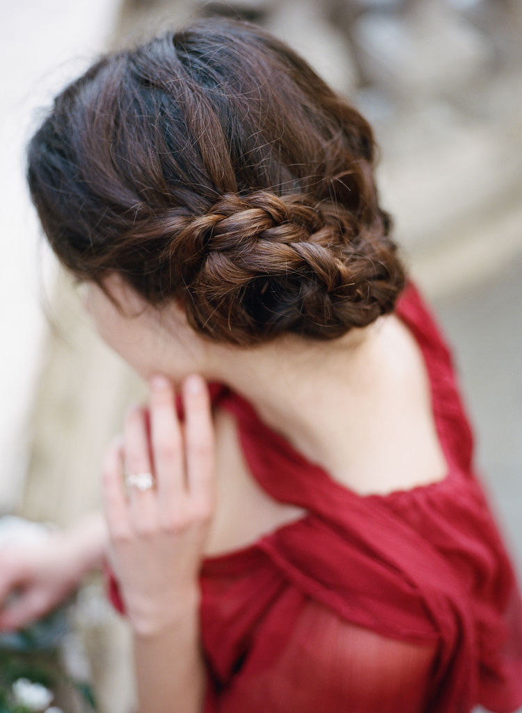 Back view of the bride with her braided hair in a bun