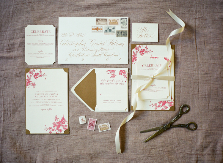 Wedding invitation suite with white paper, pink detailing and gold backing