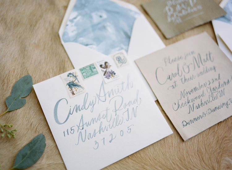 Beautiful wedding invitation suite with blue watercolor, and natural tones and blue calligraphy