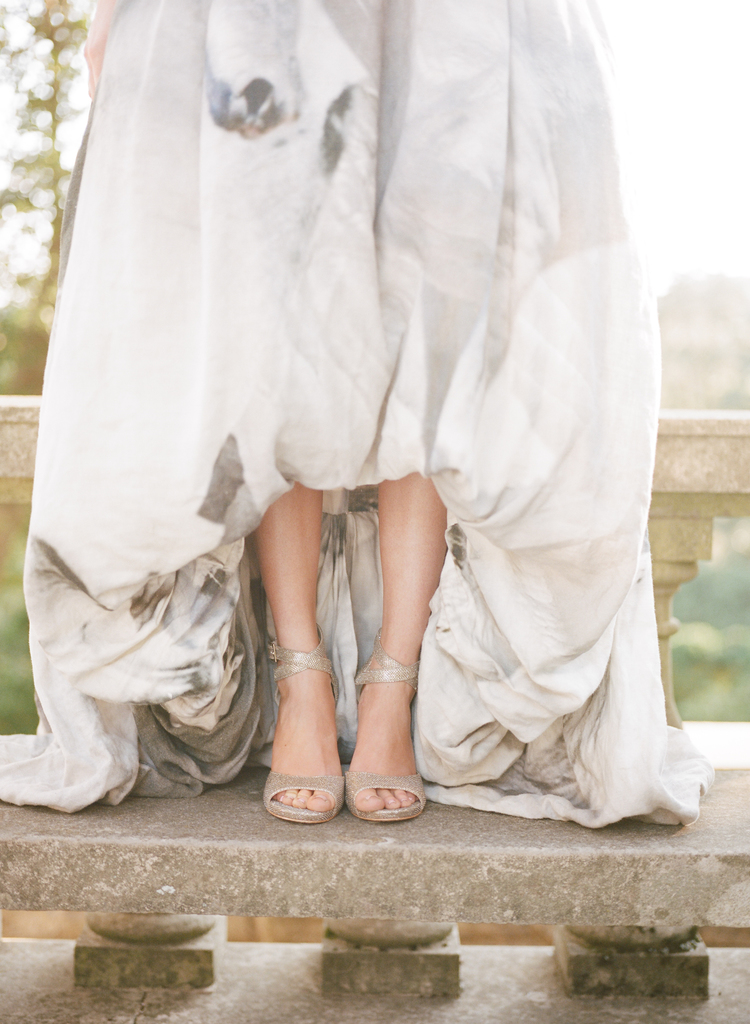 Brides white and grey patterned wedding dress and gold sparkly pumps