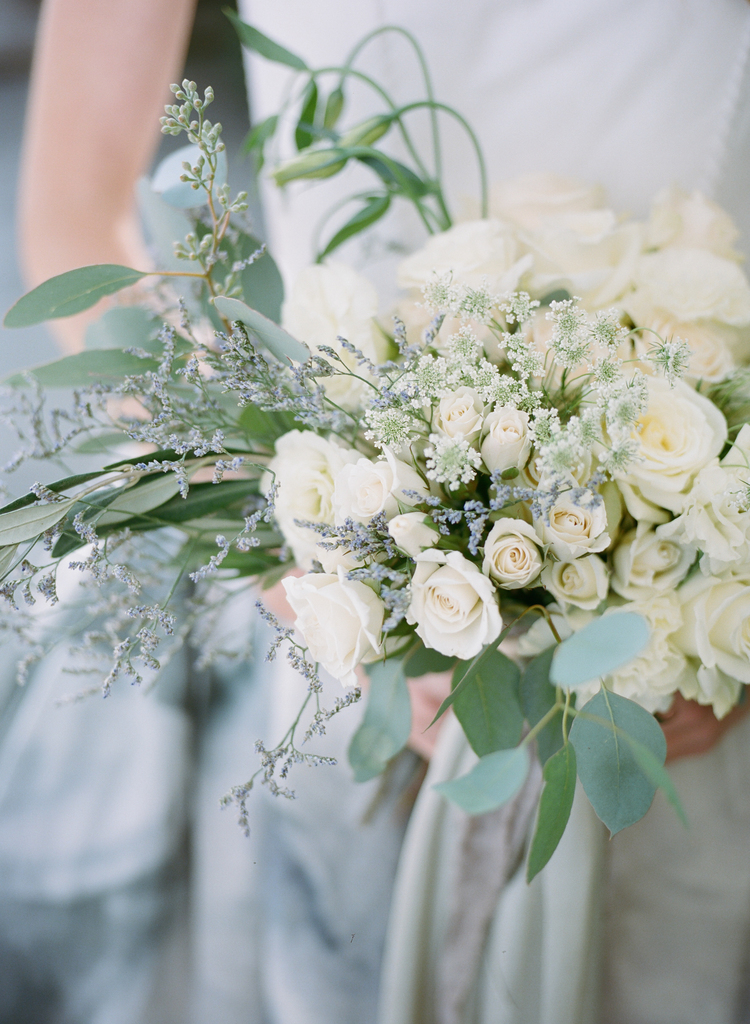 White rose bouquet with eucalyptus, greenery and baby's breath