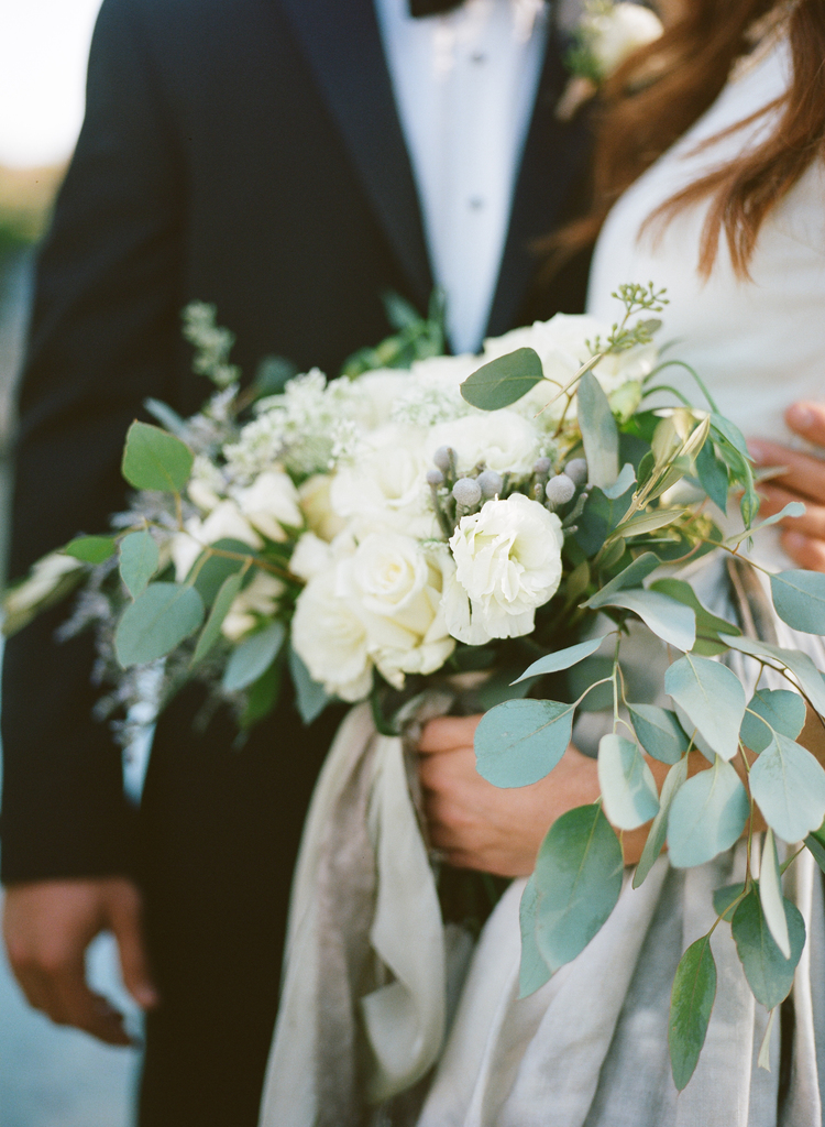 Bridal bouquet with white roses and eucalyptus