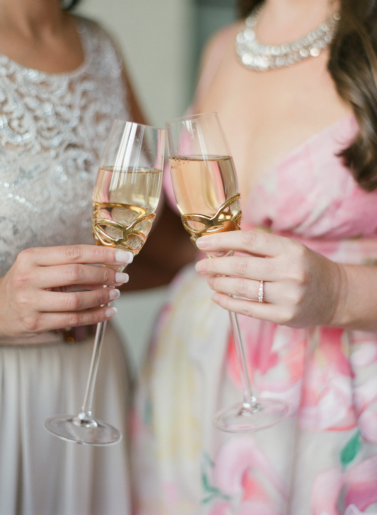 Brides toasting with their gold champagne glasses