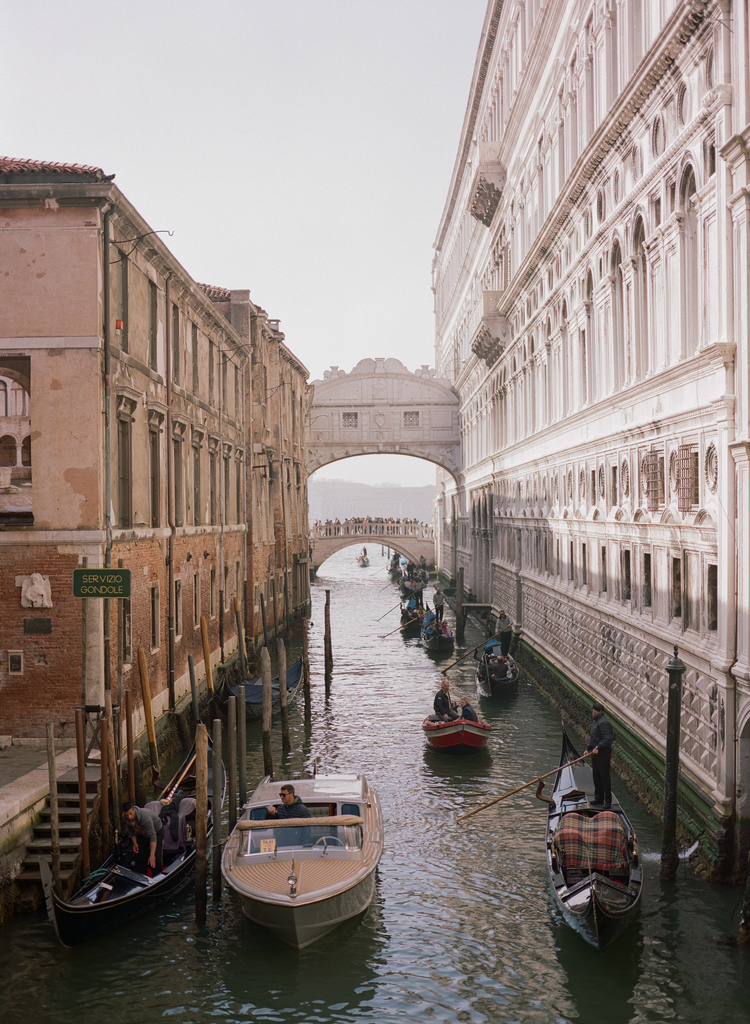 View of the Venice water roads with boats and gondolas going through the channels
