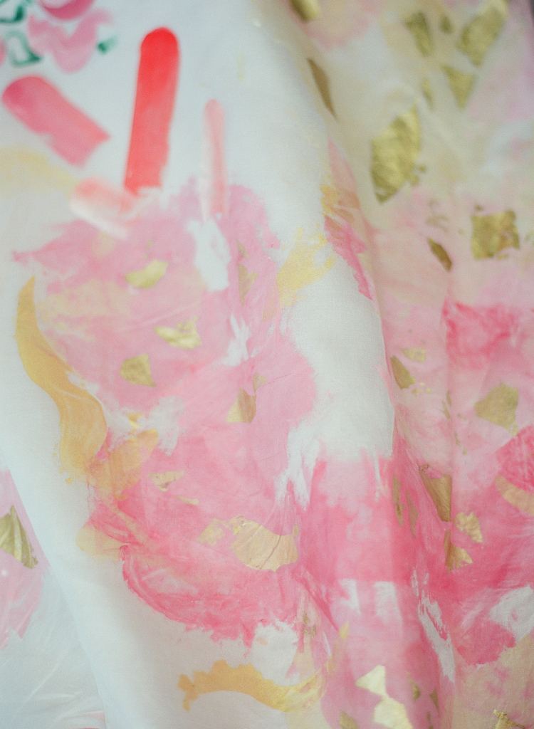 Shades of pink and gold leaf on a brides wedding dress