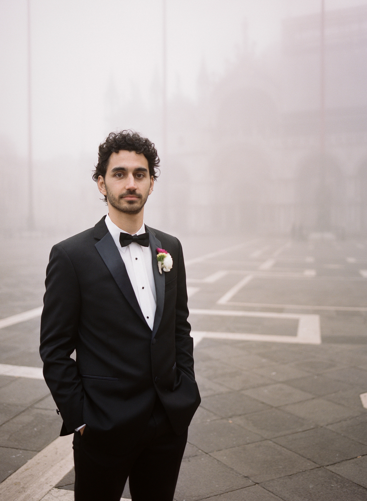 Groom standing in the Piazza Sam Marco with fog in the background