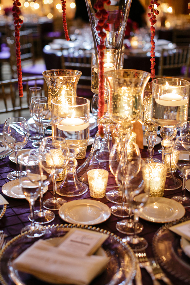 Mercury glass candle holders and tea lights on a purple table linen