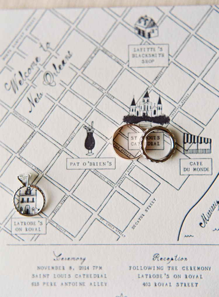 Wedding bands sit on top of a grid map of the New Orleans French Quarter over the St. Louis Cathedral and Latrobe's
