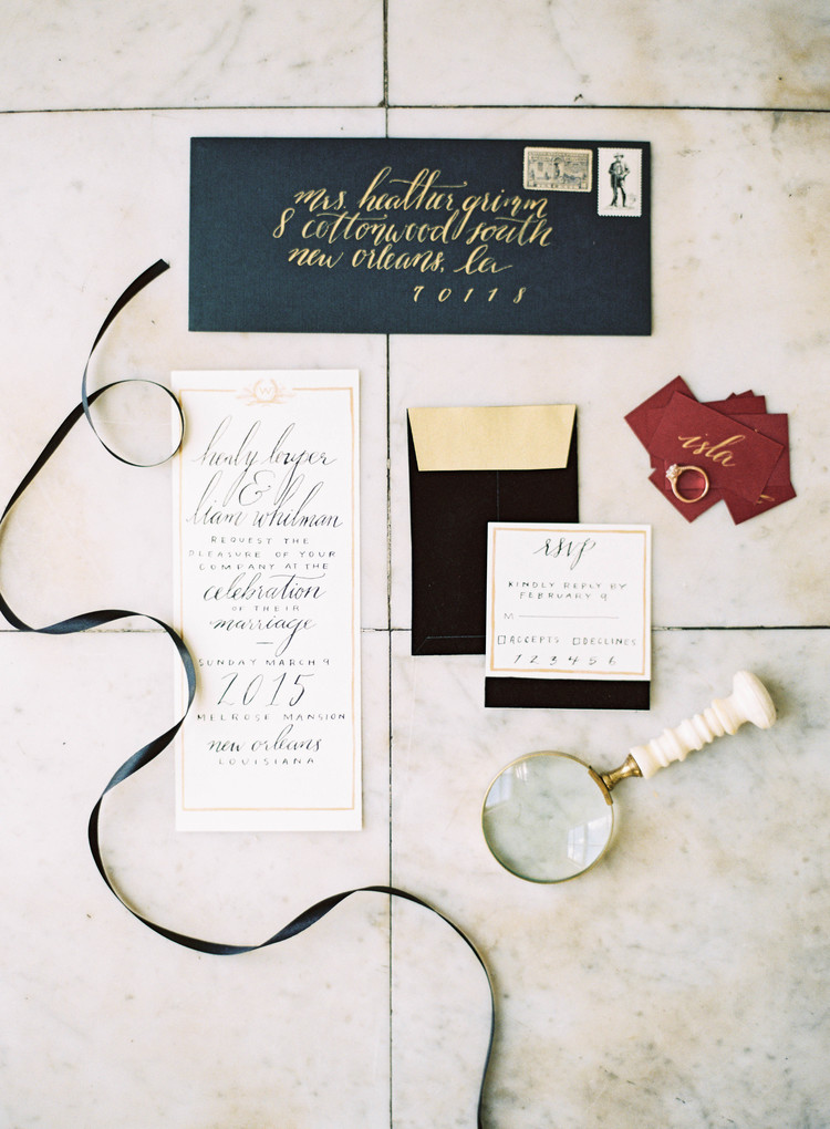 Wedding invitation suite with black calligraphy and dark red name cards