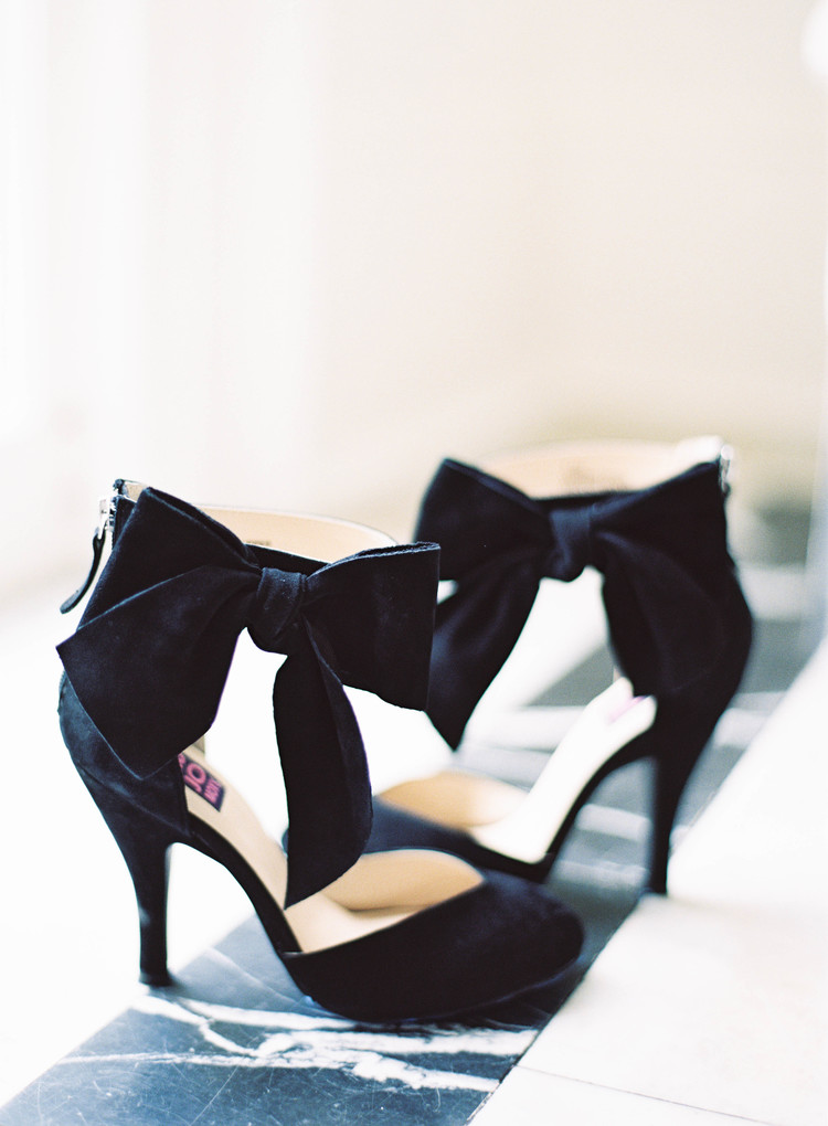 Black velvet  evening shoes with a bow on the ankle strap