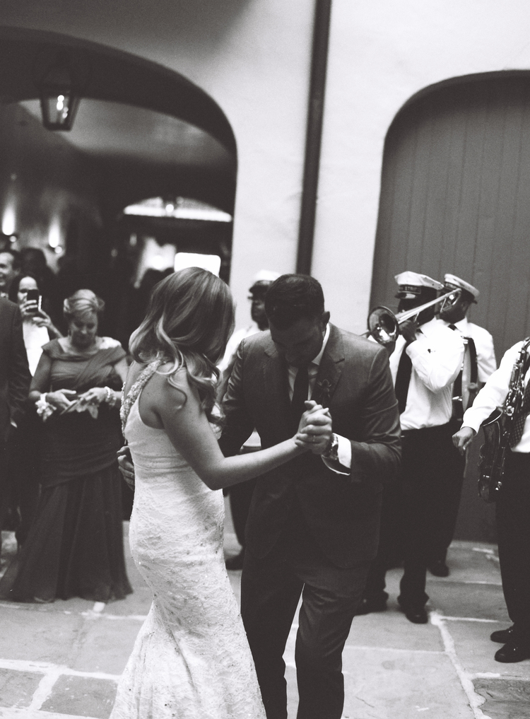 bride and groom dancing to a jazz band in New Orleans