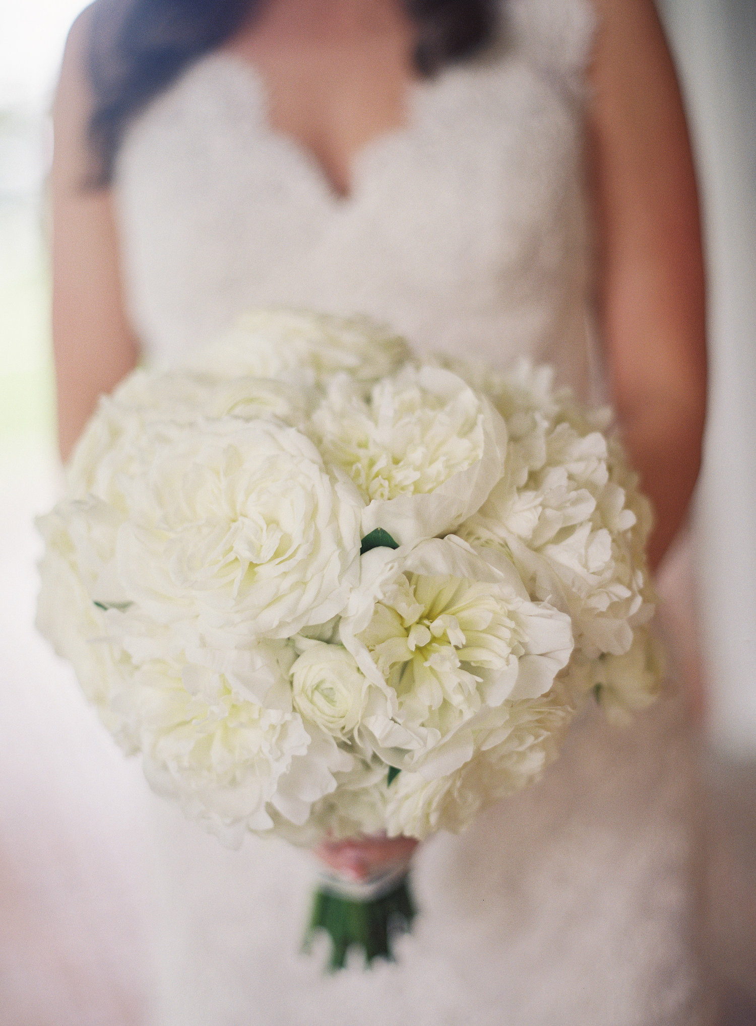 Brides white bouquet with greenery