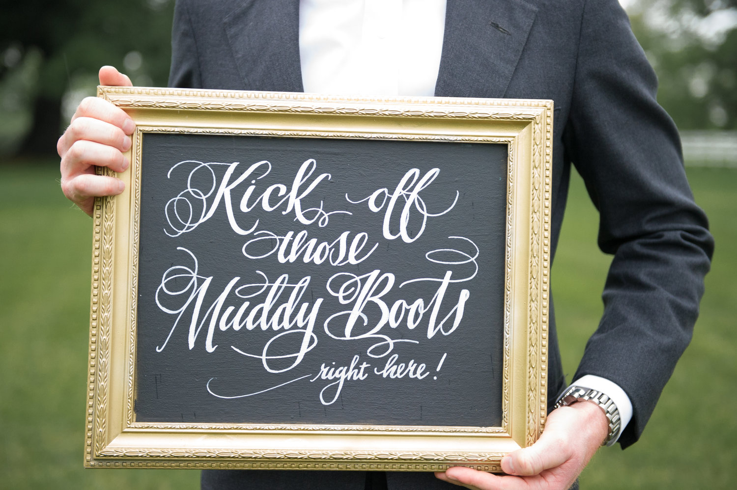 "chalk board with ""kick off those buddy Boots right here!"" sign"