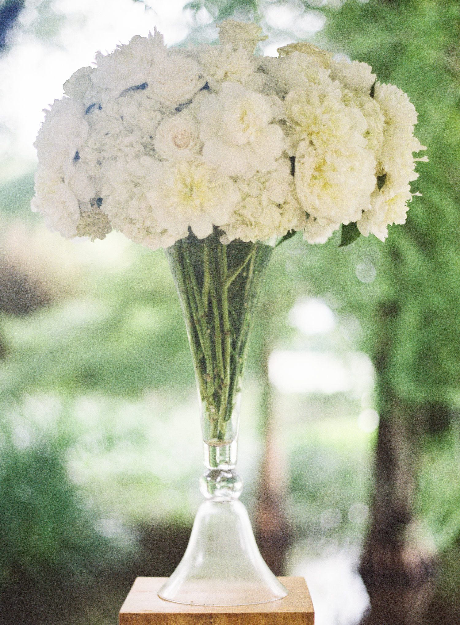 Beautiful tall lush arrangement of white flowers at the wedding reception