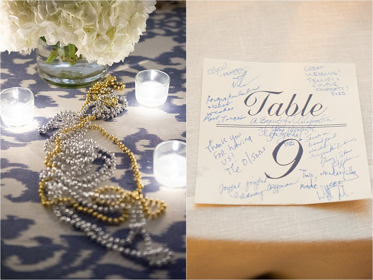 silver and gold mardi gras beads on the white and blue pattern table linens, table numbers signed by the guests