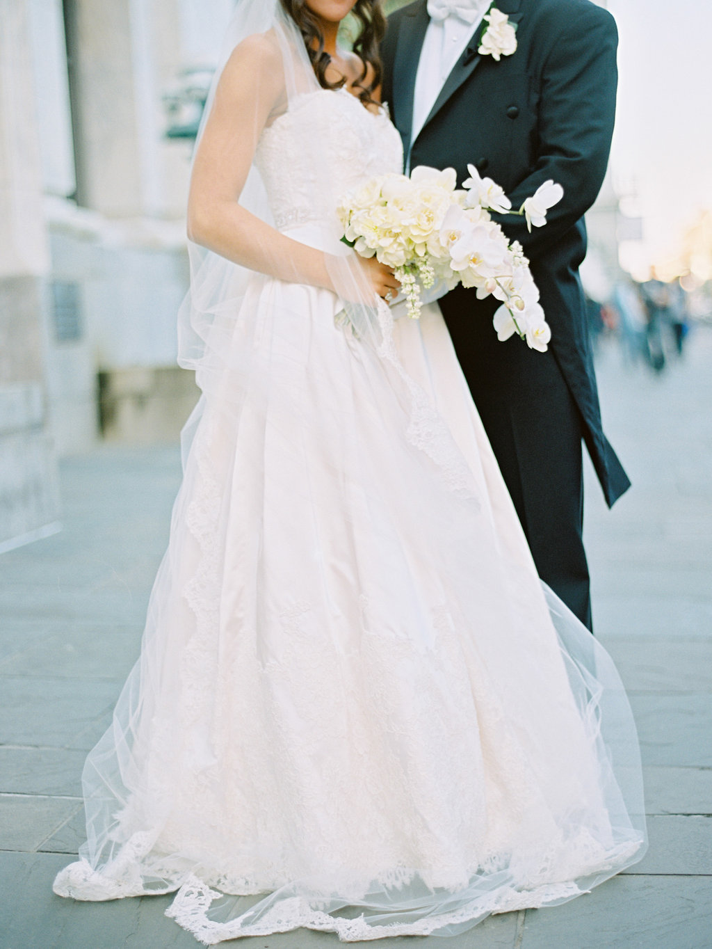 Bride and groom with their orchid bouquet and boutonnière