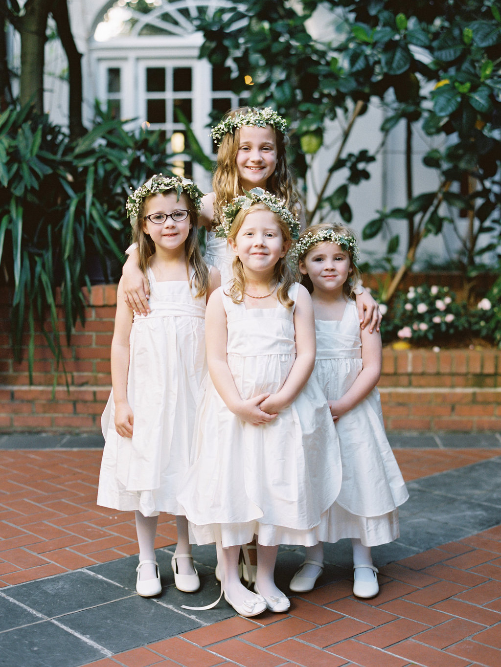 junior bridesmaids and flower girls in their white dresses and baby breaths headbands
