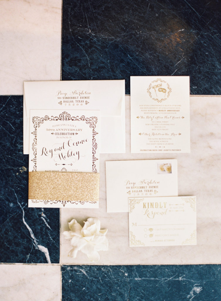 invitation suite for golden anniversary, with intricate border and gold letterpress details