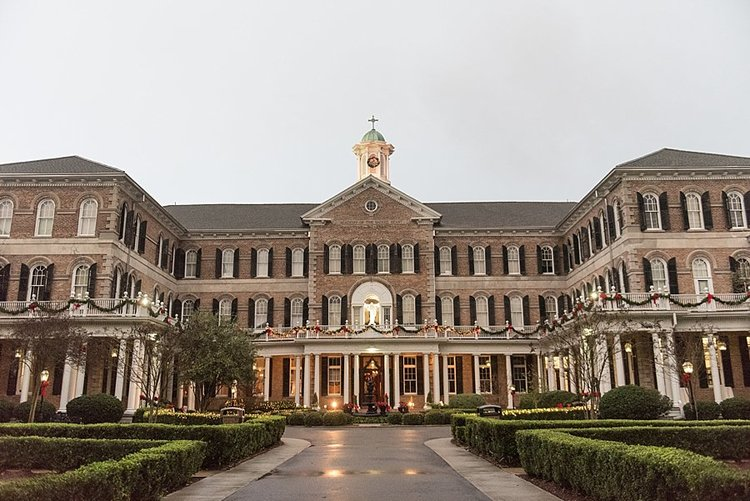 the beautiful Academy of Sacred Heart building in New Orleans is brick with black shutters and a gorgeous courtyard