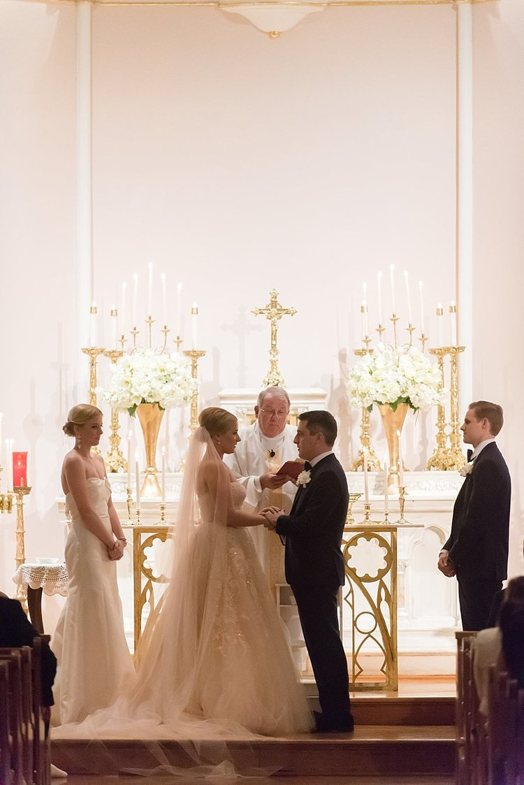 Elegant wedding ceremony with flickering candelabras and a couple saying their vows to each other