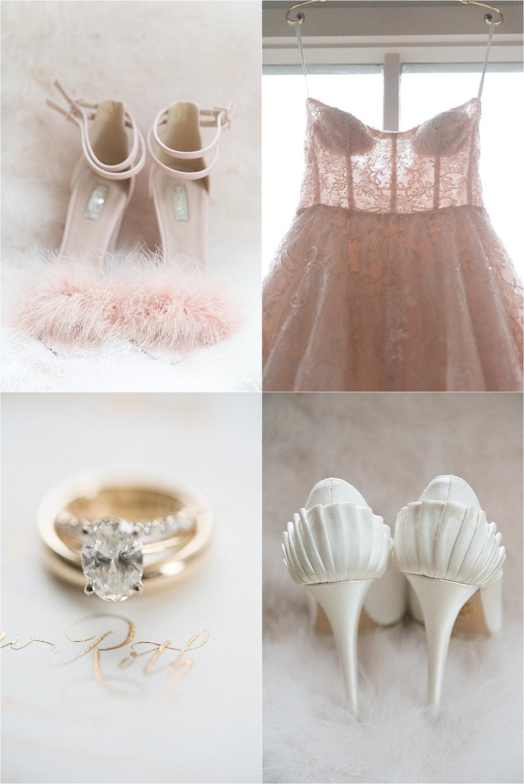 blush pink pumps with pom poms, blush wedding gown hanging in the window with lace details, diamond engagement ring sitting in grooms gold wedding band, and white scalloped pumps