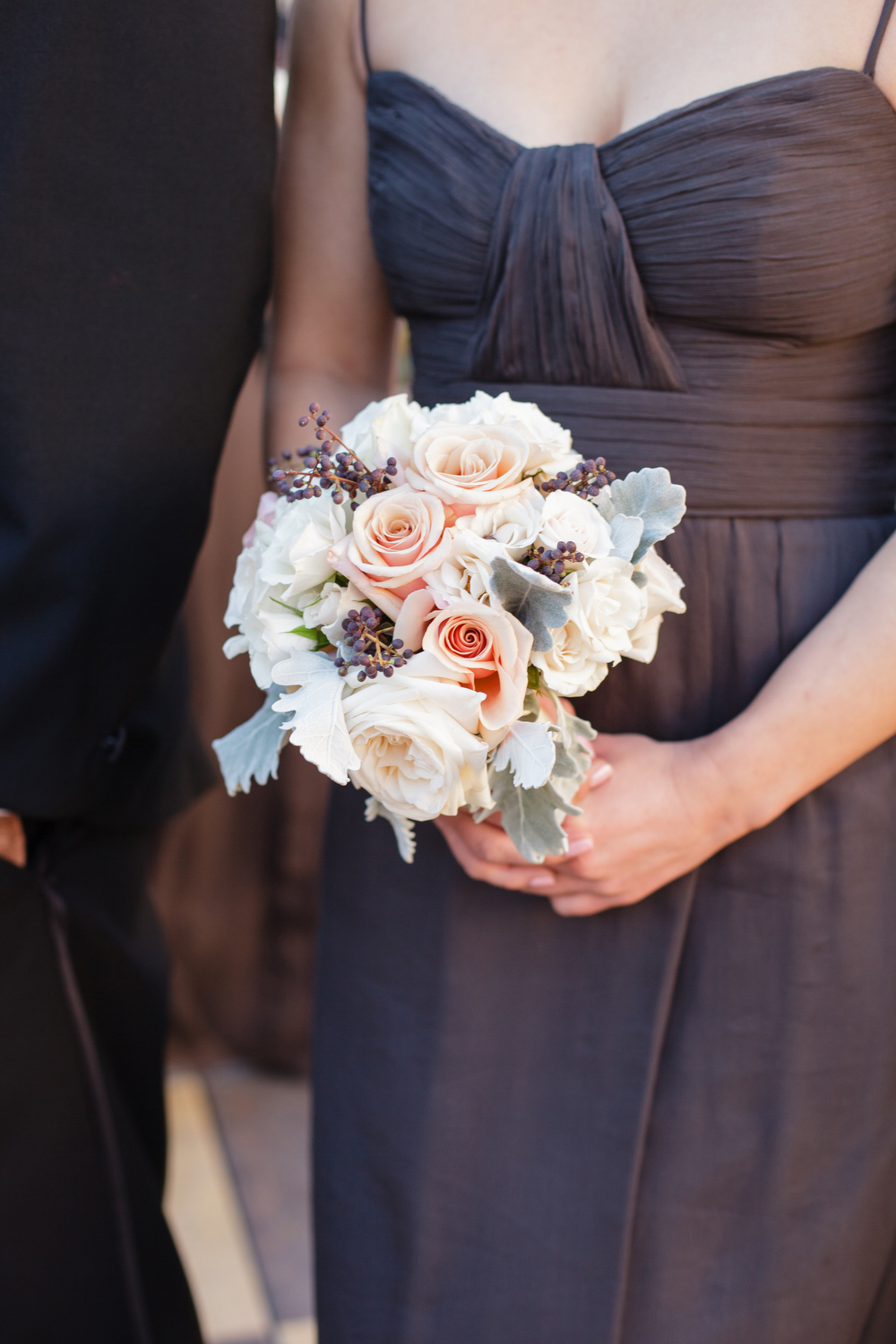 slate gray bridesmaids dress closeup holding bridesmaid bouquet with white and blush roses