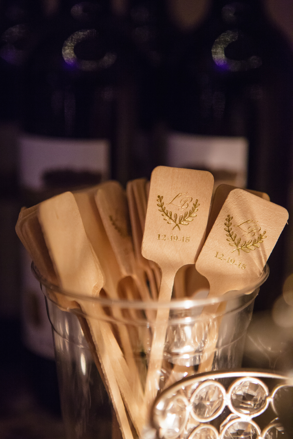 wooden engraved with gold stir sticks for cocktails at bar closeup