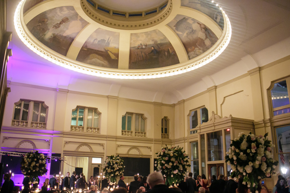 ceiling with mural and lights in a dome with wedding guests at reception
