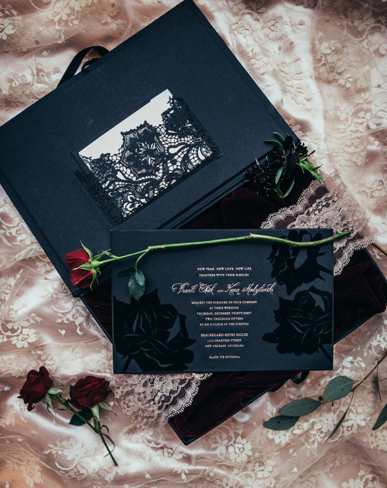 Black velvet and lace detailing on the wedding invitation