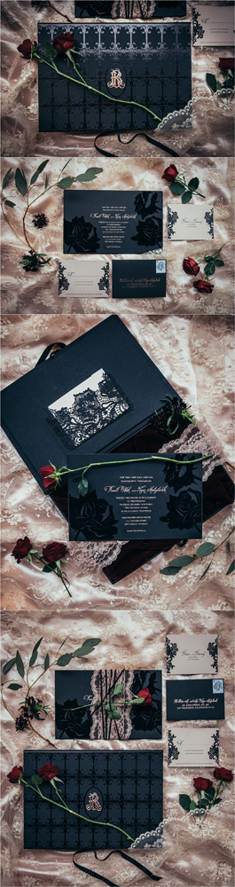 intricate cut black lace wedding invitation suite with deep red roses and gold monogram