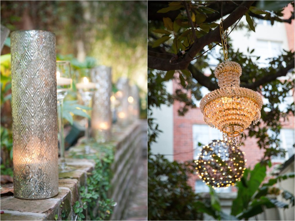 pillar candles in mercury glass vases and crystal chandeliers hanging from tree branches