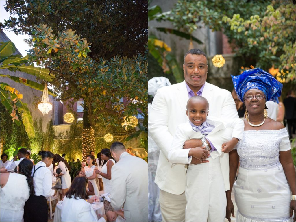 candid shot of guests dressed in all white outdoors in a courtyard at a wedding reception