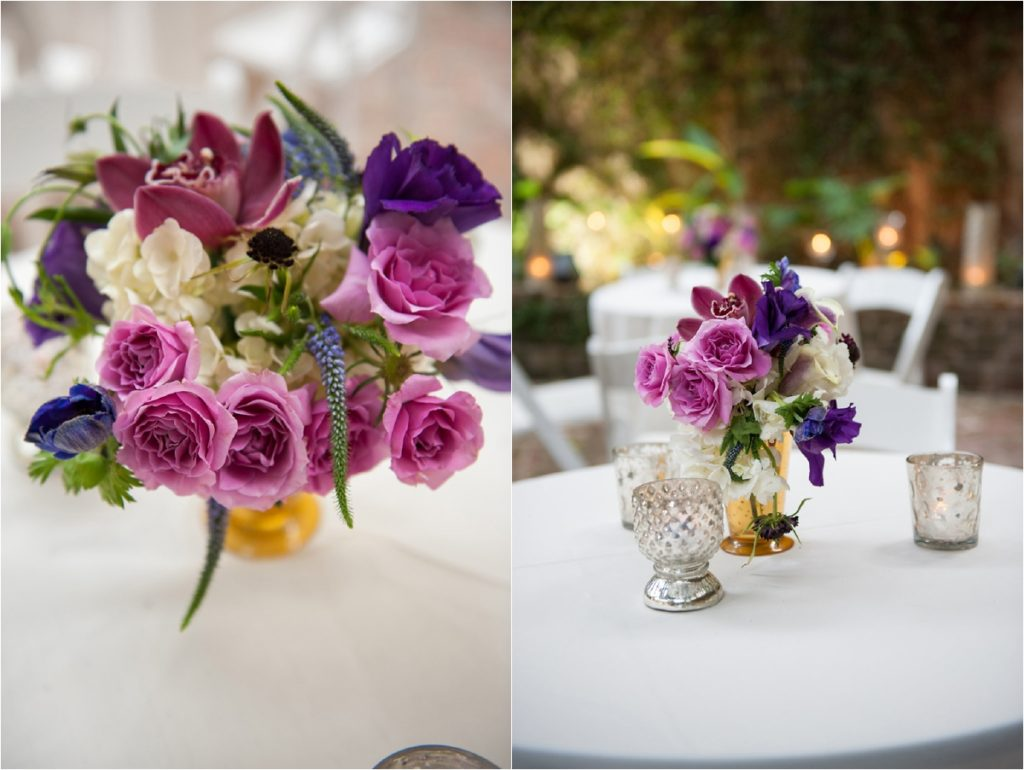 floral centerpieces in purple, pink, white, and green in gold vases sitting on tables