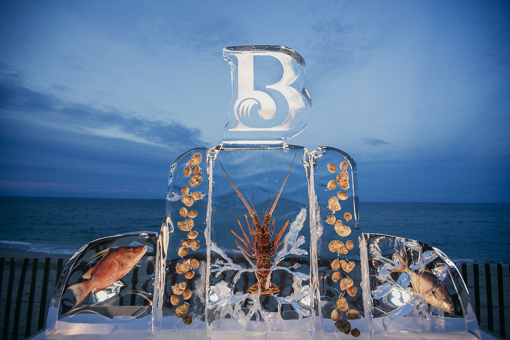 carved ice display with whole fish, lobster, and shrimp