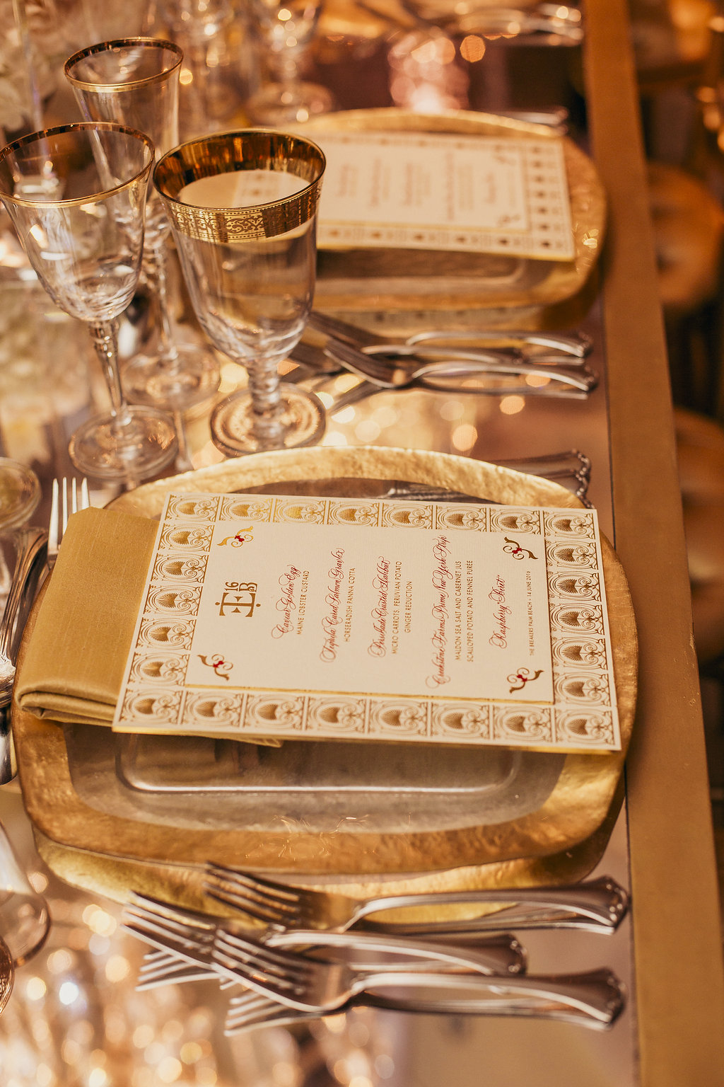 Place setting at a dinner table close up of menu and napkin