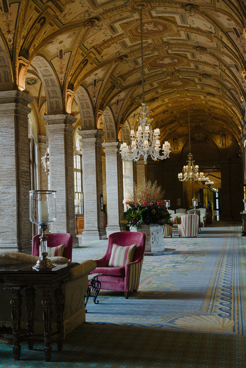 registration lobby with chairs and tables at the breakers palm beach